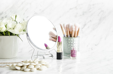 Feminine accessories on a marble dressing table. Wall mural