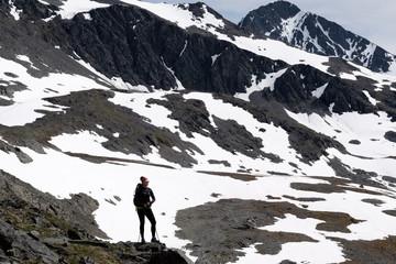 Hiker in the mountains near Thompson Pass, Alaska