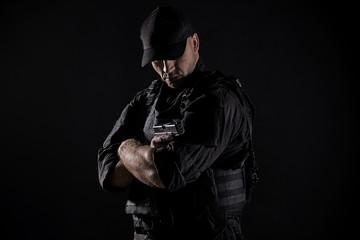 Spec ops police officer SWAT in black uniform