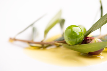 Three olives and olive oils with leaves