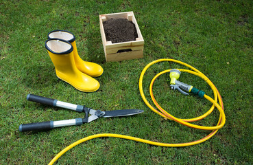 Lawn maintenance equipment on grass