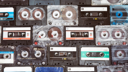 Vintage audio cassette on a wooden background. Collection of various retro audio tapes