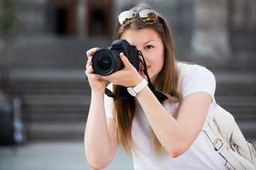 Woman taking pictures outdoors