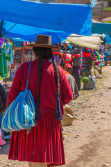 Traditional Hat and Clothing of a Peruvian Woman at the Pisac Outdoor Market, Sacred Valley, Peru