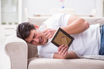 Young man unhappy in broken love concept