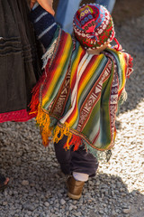 Colorful Woven Serape on a Peruvian Child