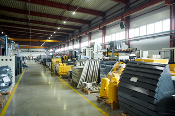 Wide angle shot of empty plant  workshop with machines and parts ready for assembling, copy space