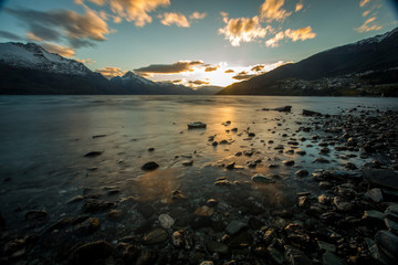 Sunset by Queenstown lake Wakatipu in New Zealand