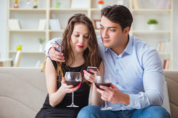 Young pair drinking wine in romantic concept