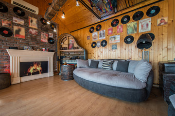 Decorated walls in music theme in living room interior