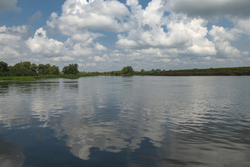 River with blue sky and clouds  in summer day