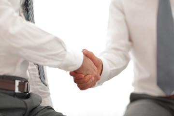 close up.handshake of business people on a light background