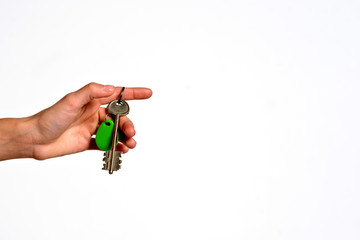 Hand giving keys isolated on white background