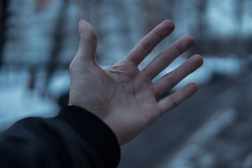 Hand in the cold.Blurred background