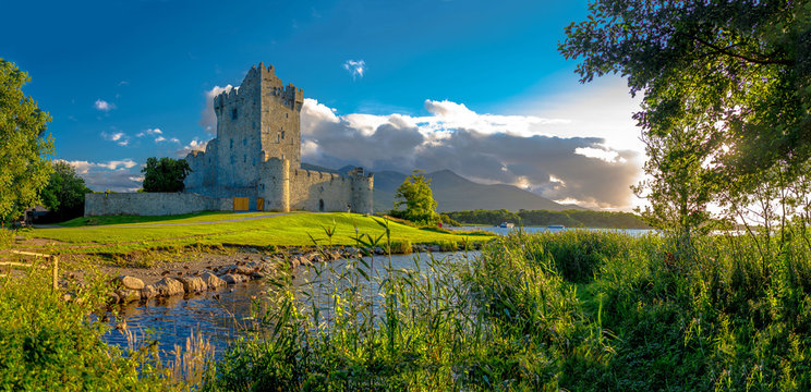 Idyllic landscape of Ross Castle in the Killarney National Park in Ireland. Travel by car through the Ring of Kerry.