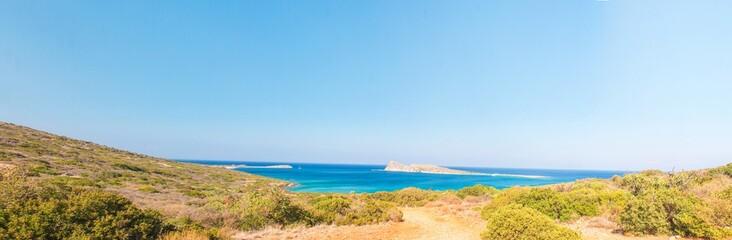 Beautiful bay with turquoise water. A popular tourist beach. Kolokitha beach. Peninsula Kalydon. Crete, Elounda,Greece.Panoramic view HD.