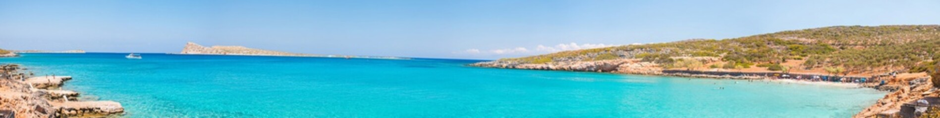 Beautiful bay with turquoise water. A popular tourist beach. Kolokitha beach. Peninsula Kalydon. Crete, Elounda,Greece.Panoramic view HD.