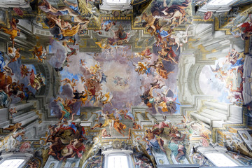 Paintings and frescos on the ceiling of a catholic Church of St. Ignatius of Loyola at Campus Martius, in Rome, Italy
