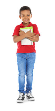 Little African-American child with school supplies on white background