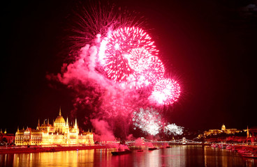Fireworks explode over Danube River during Saint Stephen's Day in Budapest