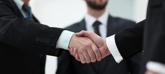 closeup handshake proven business partners