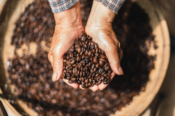 Foto op Aluminium Koffiebonen Roasted coffee Arabica coffee quality In the hands of the farmer