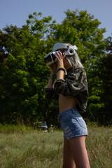 millennial wearing a VR Headset outside