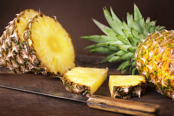 Wall Mural - sliced pineapple on wooden background