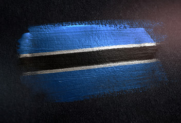 Botswana Flag Made of Metallic Brush Paint on Grunge Dark Wall