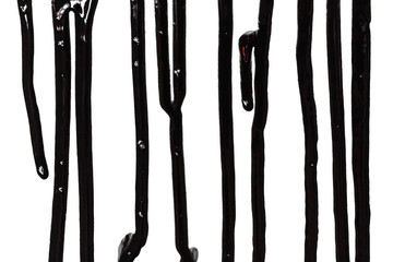 Flows of black paint close-up isolated on a white background