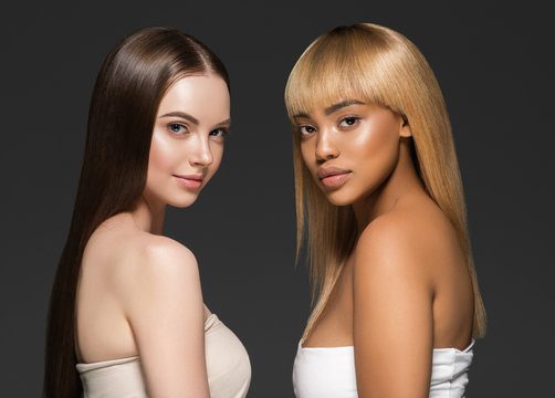 Ethnic beauty skin two women beauty face healthy skin and different colors african and caucasian