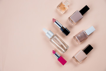 Close up view of cosmetic theme objects on beige background.Top view.Copy space.cosmetics, self-care, perfume, nail Polish, lipstick composition, flat lay. Make-up concept