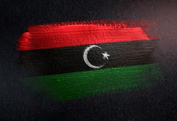 Libya Flag Made of Metallic Brush Paint on Grunge Dark Wall