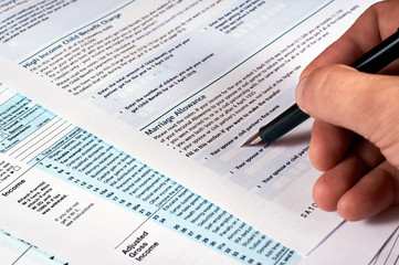 Tax reporting. Human completes the tax form