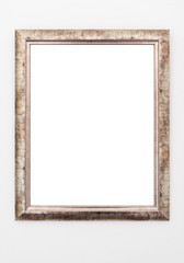 empty ornate picture frame hanging on wall background template