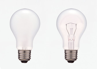 Two electric light bulbs with and without filament, isolated on white background with clipping mask.