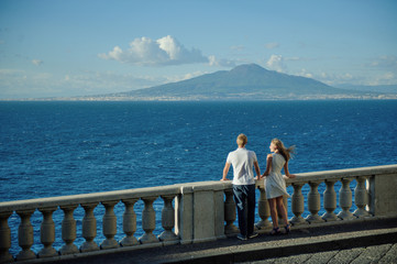 Young romantic couple on a background of a sea landscape and Vesuvius, Naples, Italy
