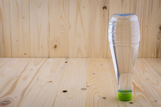 Drinking water bottles on a wooden floor