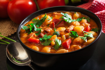 White bean soup with potatoes, tomatoes, paprika, and bacon
