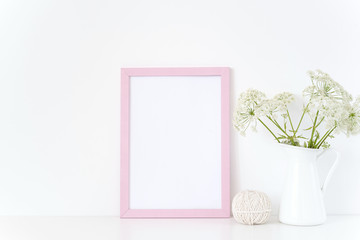Pink frame mock up with a wild host in jug. Mockup for quote,design. Template for small businesses,bloggers,social media. poster mockup