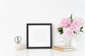 White portrait frame mock up with a pink peonies beside the frame, overlay your quote, promotion, headline, or design, great for small businesses, lifestyle bloggers and social media campaigns. poster