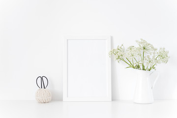 Vintage white frame mock up with wild host in jug.Mockup for headline, design.Template for businesses,lifestyle bloggers. poster mock up