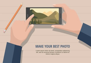 Mobile photography concept. Man looking photos of nature landscape to phone. Isolated on wooden background.