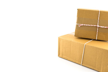 Two brown paper box  tied with red and white string ready to send isolated