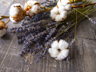 lavender and cotton on wooden table