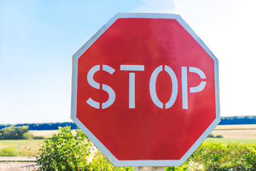 Stop sign in a country road.