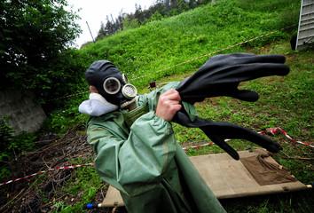People wear gas masks