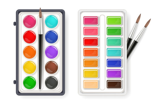 Watercolor palette drawing set with brushes isolated on white. Aquarelle different type of colors