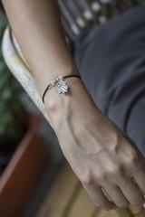 Female hand wrist resting with tiny jewelry
