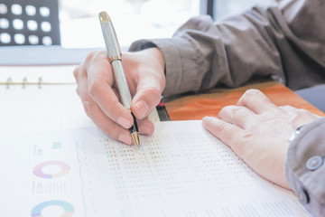Administrator business man financial inspector and secretary making report, calculating or checking balance.